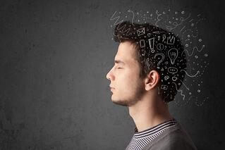 Young man thinking with white abstract lines and symbols.jpeg