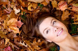 autumn girl portrait on the floor smiling